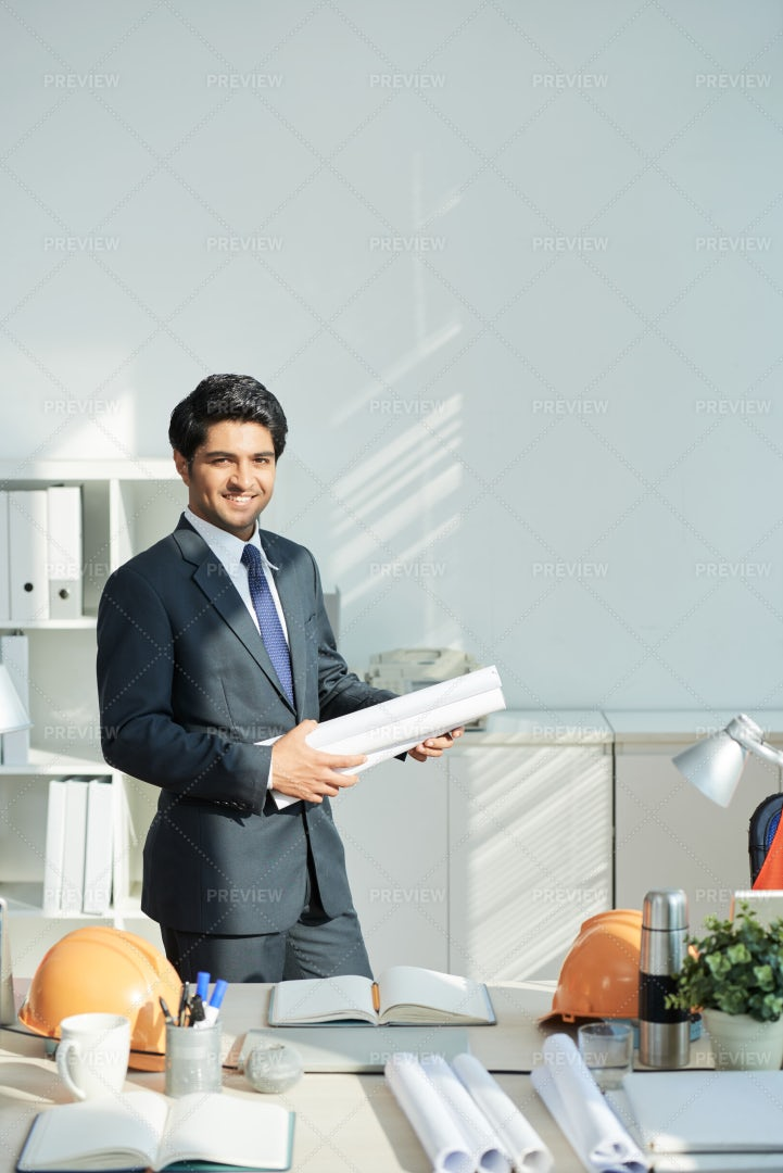 Young Engineer Working With Blueprints: Stock Photos