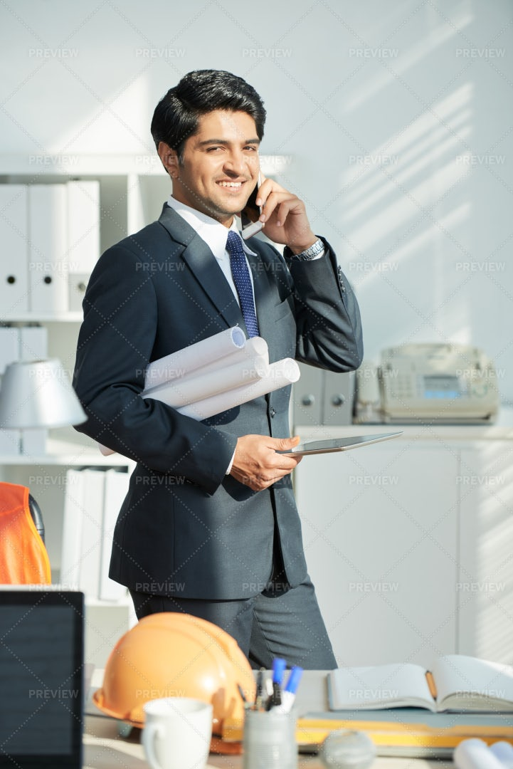 Successful Architect Working At Office: Stock Photos