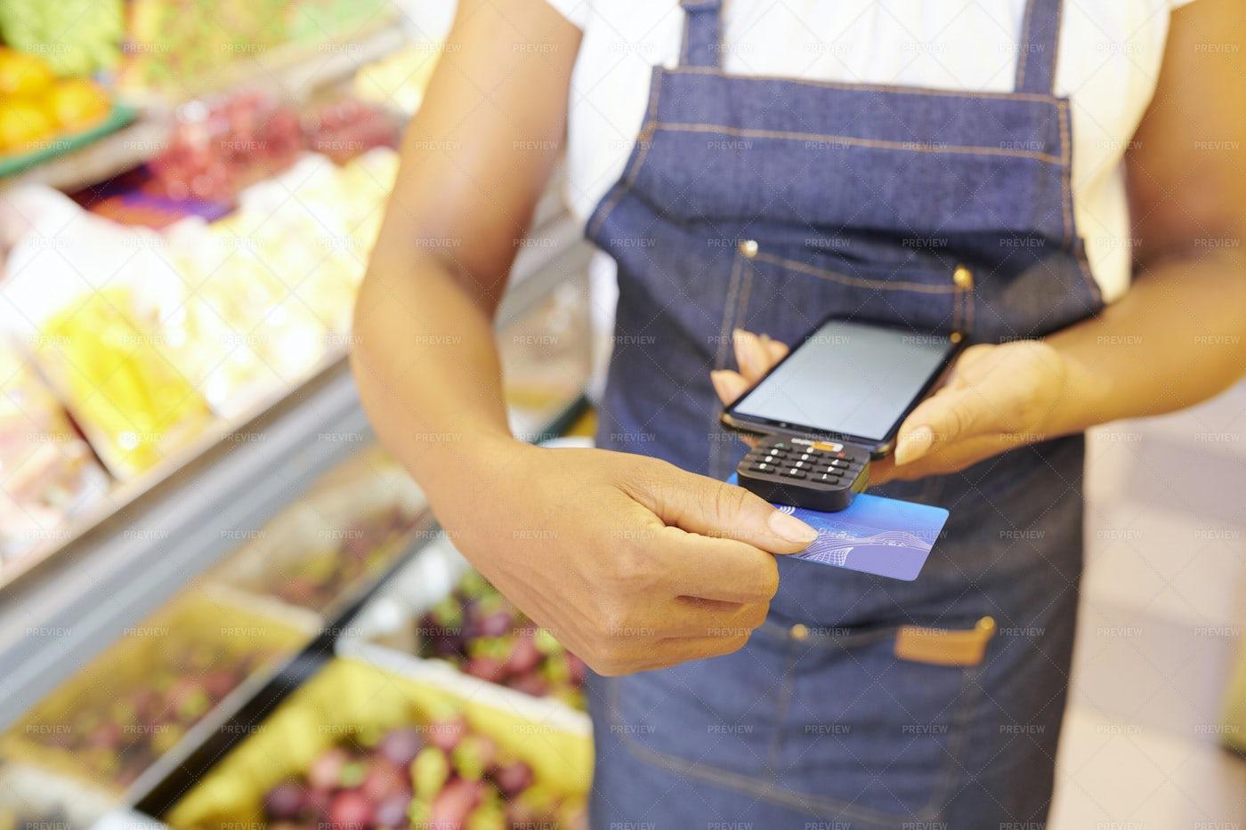 Saleswoman Accepting Payment: Stock Photos
