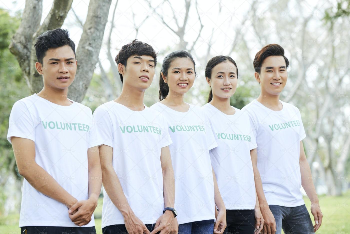 Volunteer Group Standing Outdoors: Stock Photos