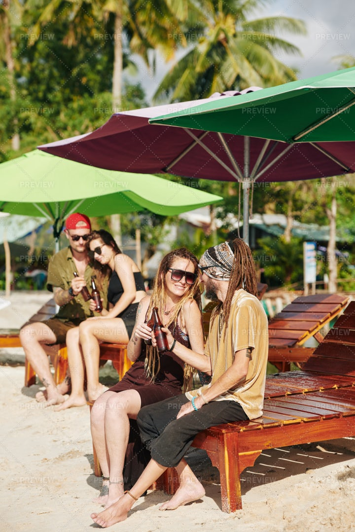 Young People Having Drinks On Beach: Stock Photos