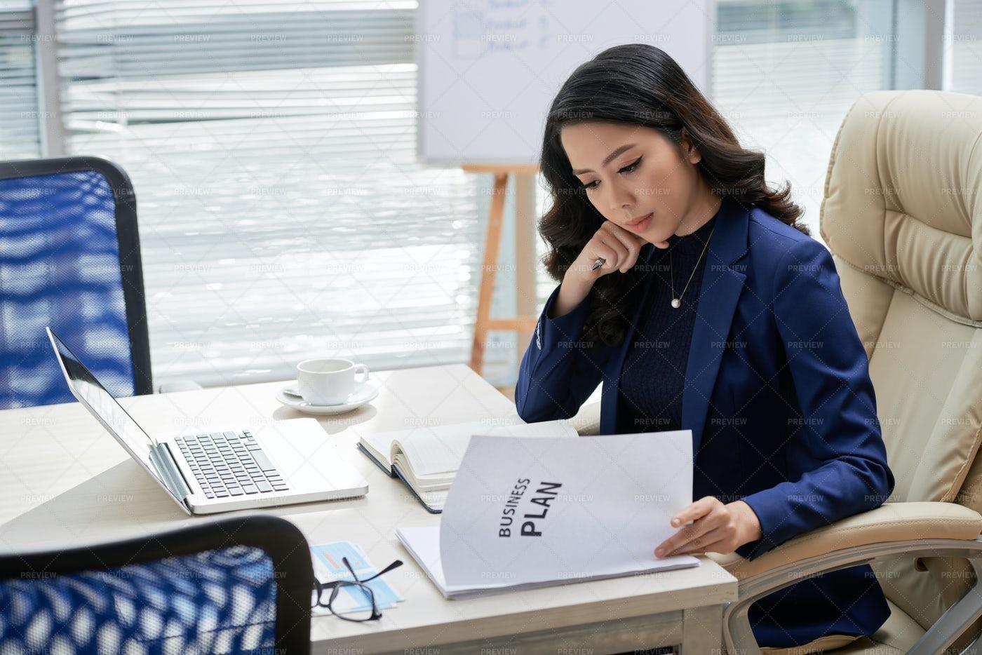 Businesswoman Examining Business Plan: Stock Photos
