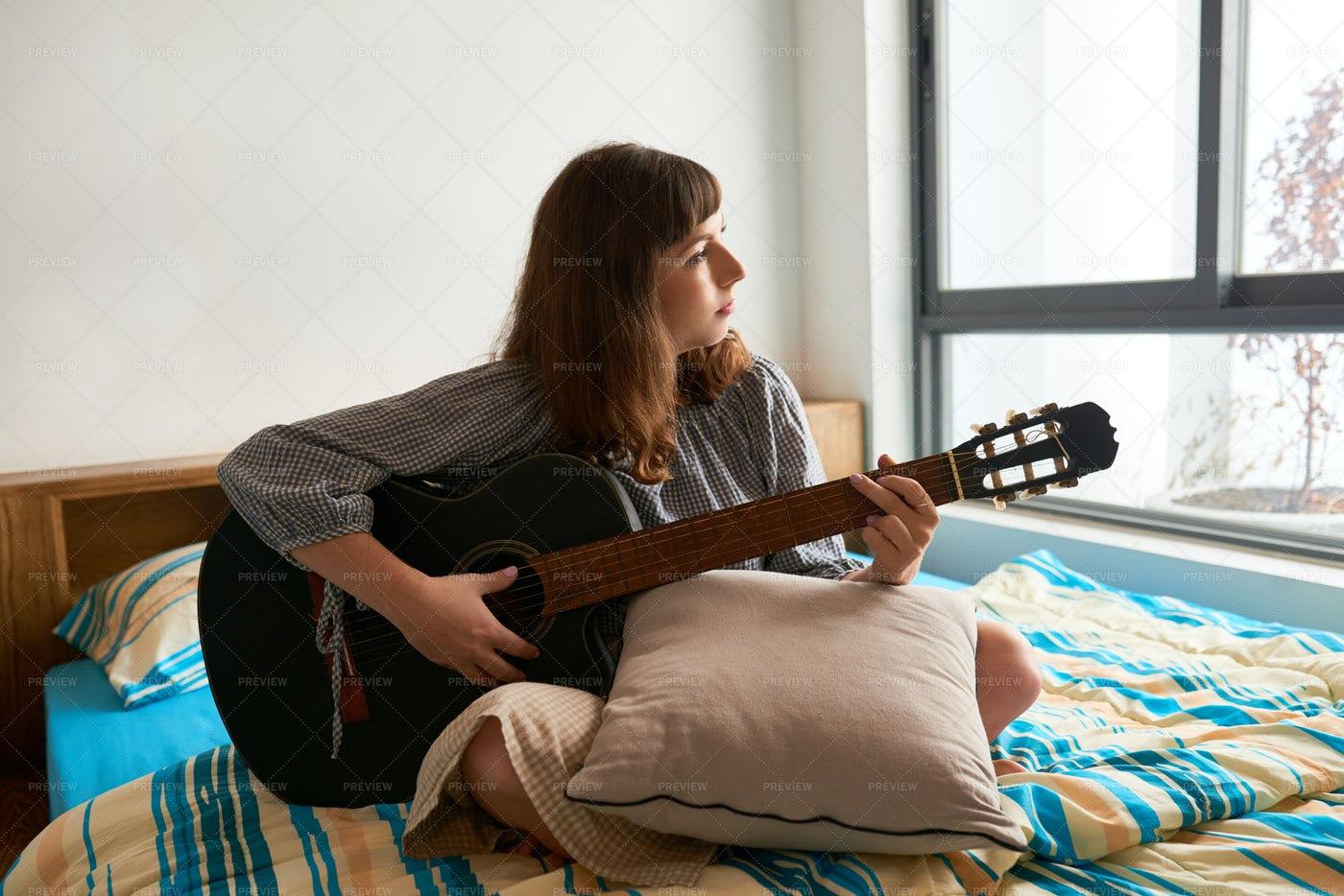 Woman Playing Guitar: Stock Photos
