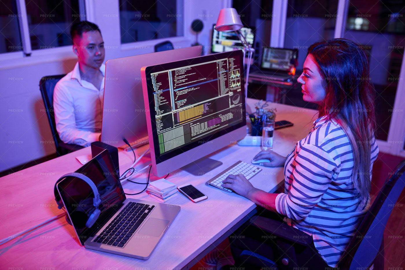 People Working In Dark Office: Stock Photos