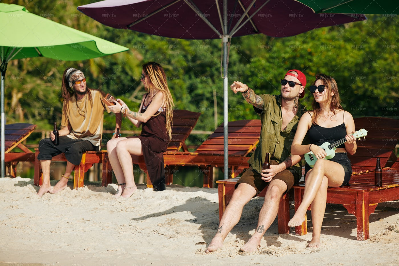 People Resting On The Beach: Stock Photos