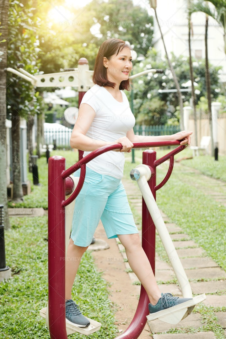 Woman Working Out In Exercise Equipment: Stock Photos