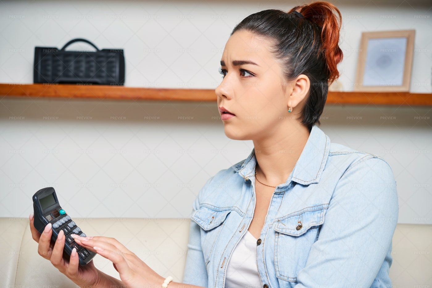 Woman Using Calculator: Stock Photos