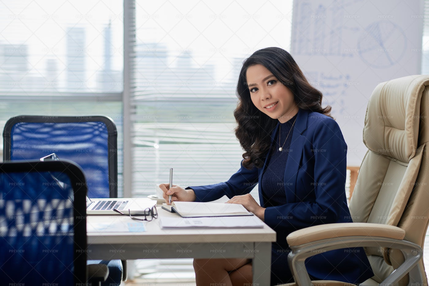 Businesswoman Planning Her Work Day At: Stock Photos