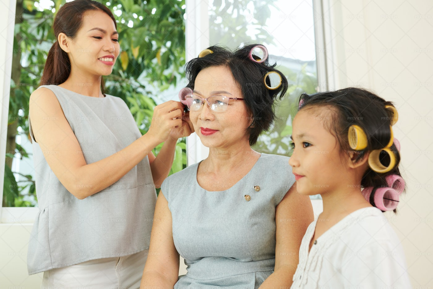 Family Making A Beauty Together: Stock Photos