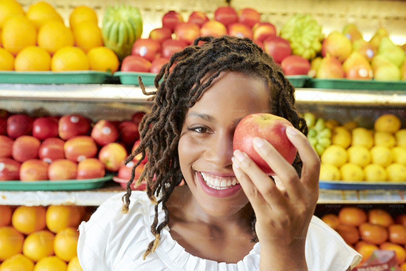 Young Woman With Apple In Store: Stock Photos