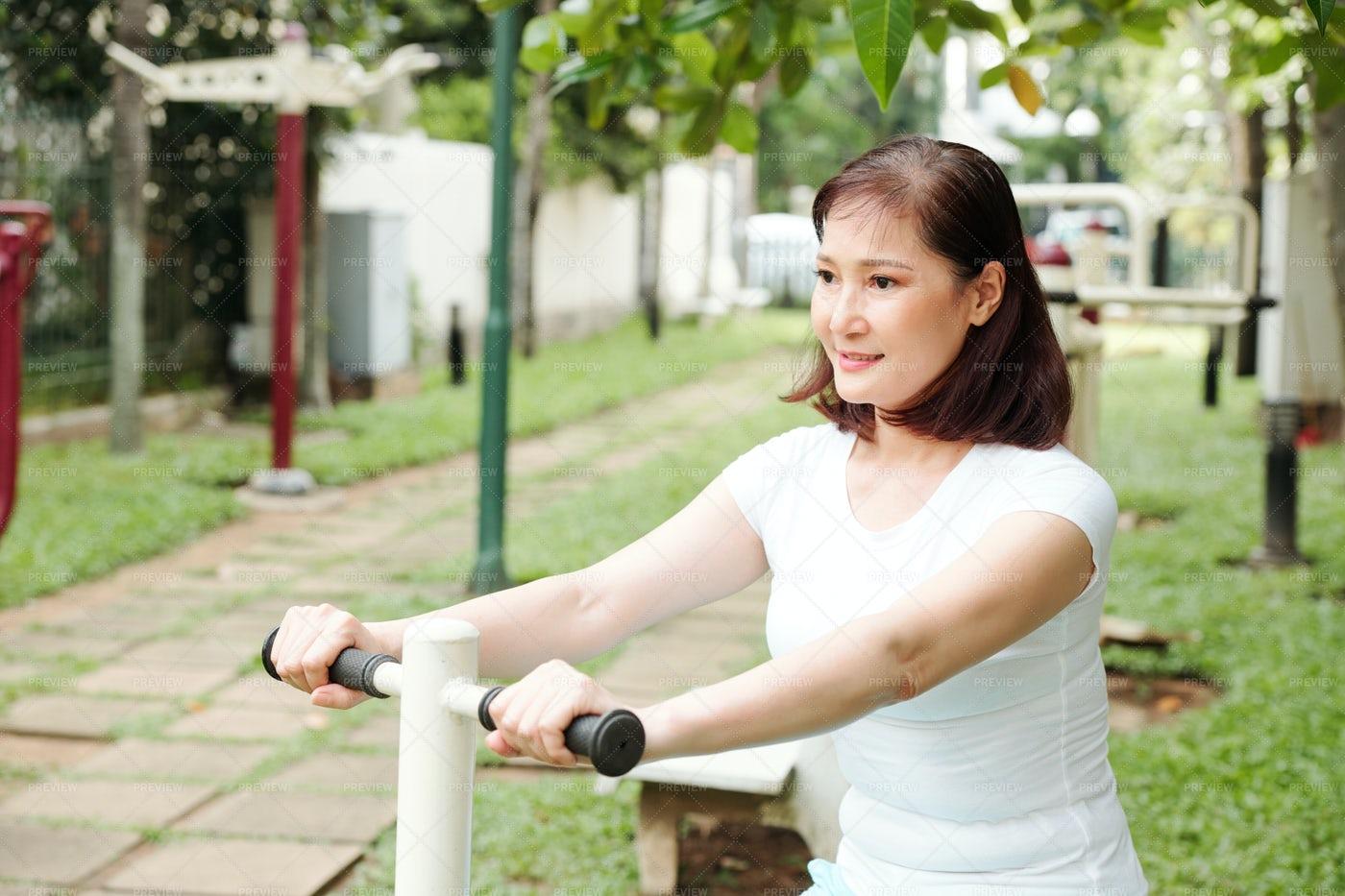 Woman Enjoying Bicycle Workout: Stock Photos