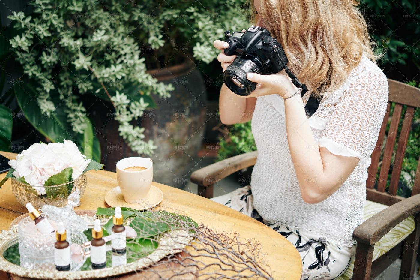 Woman Photographing Organic Cosmetics: Stock Photos