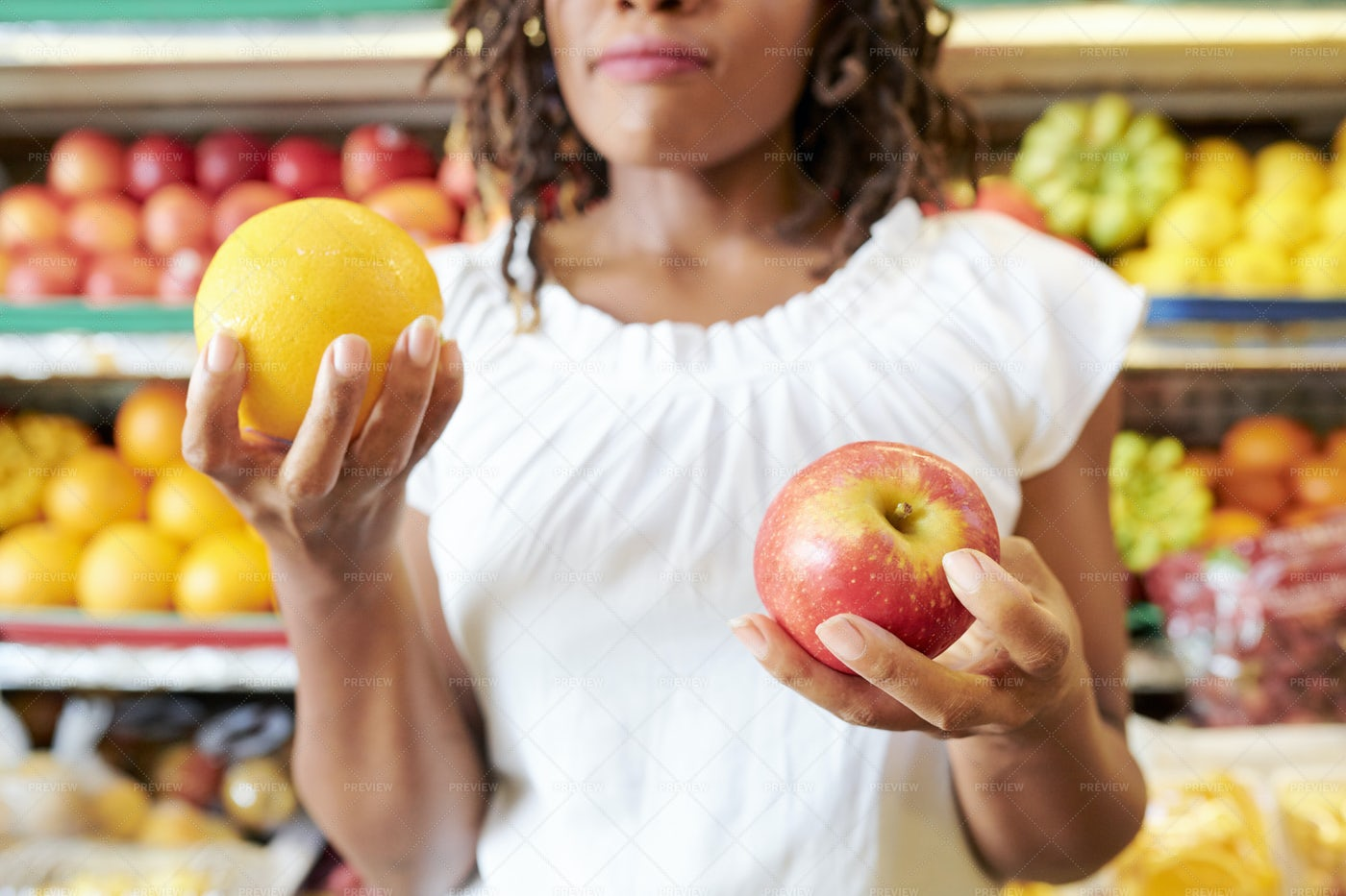 Customer Choosing Fruits To Buy: Stock Photos