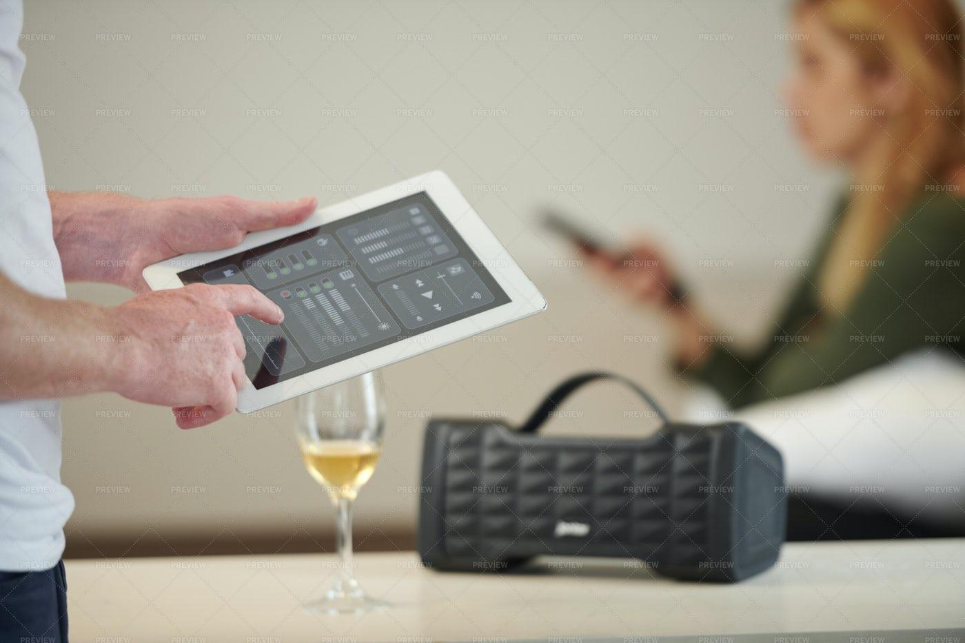 Man Increasing Speaker Volume: Stock Photos