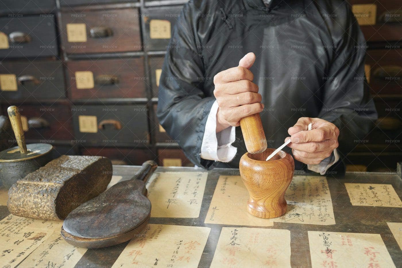 Apothecary Worker Using Pestle And: Stock Photos