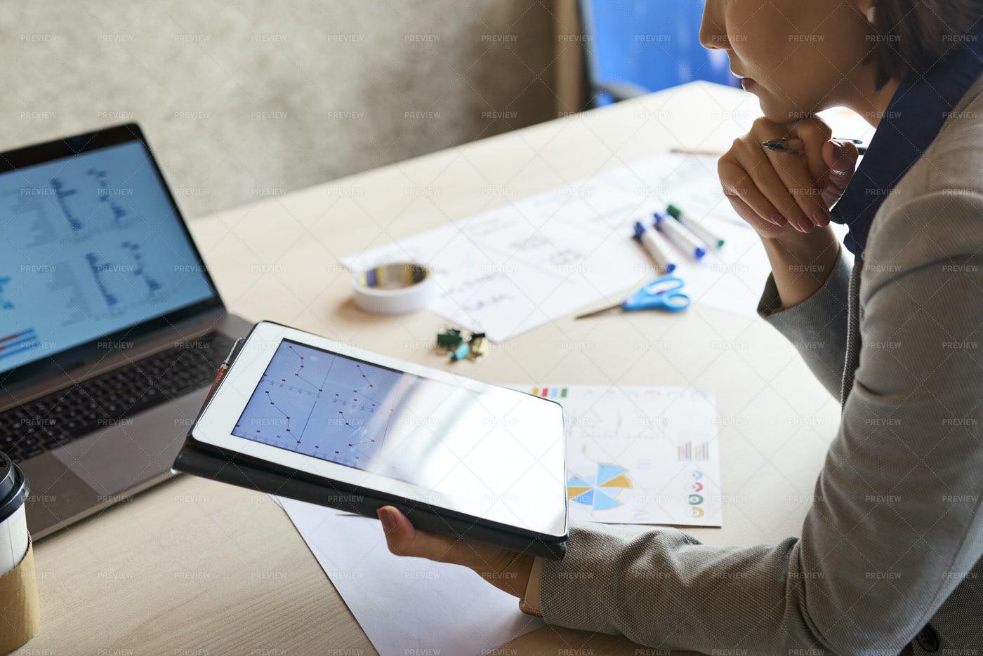 Entrepreneur Analyzing Sales Data: Stock Photos