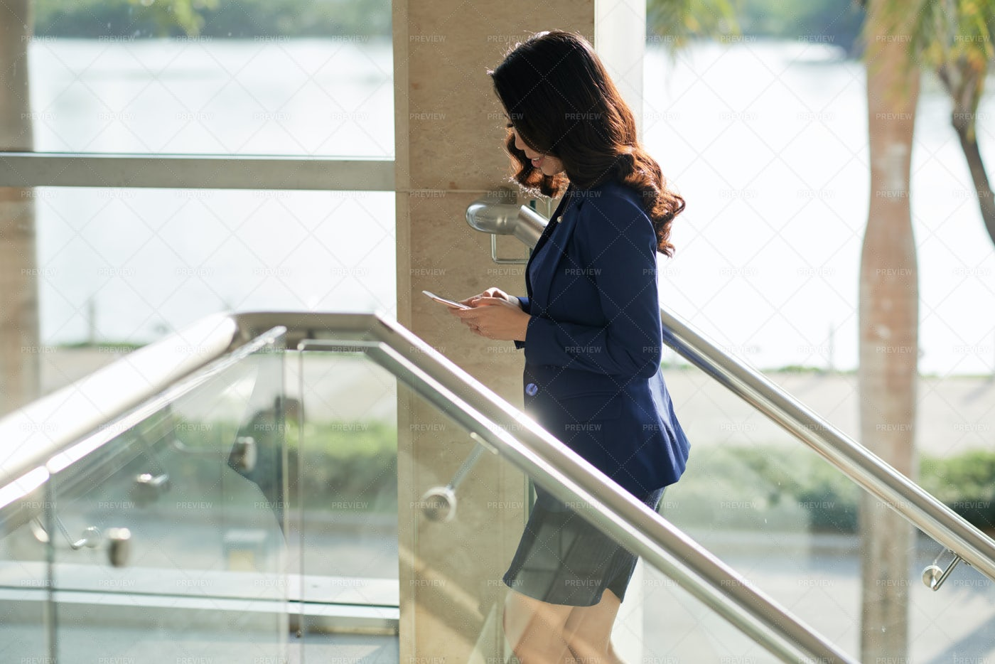 Businesswoman Using Mobile Phone At: Stock Photos