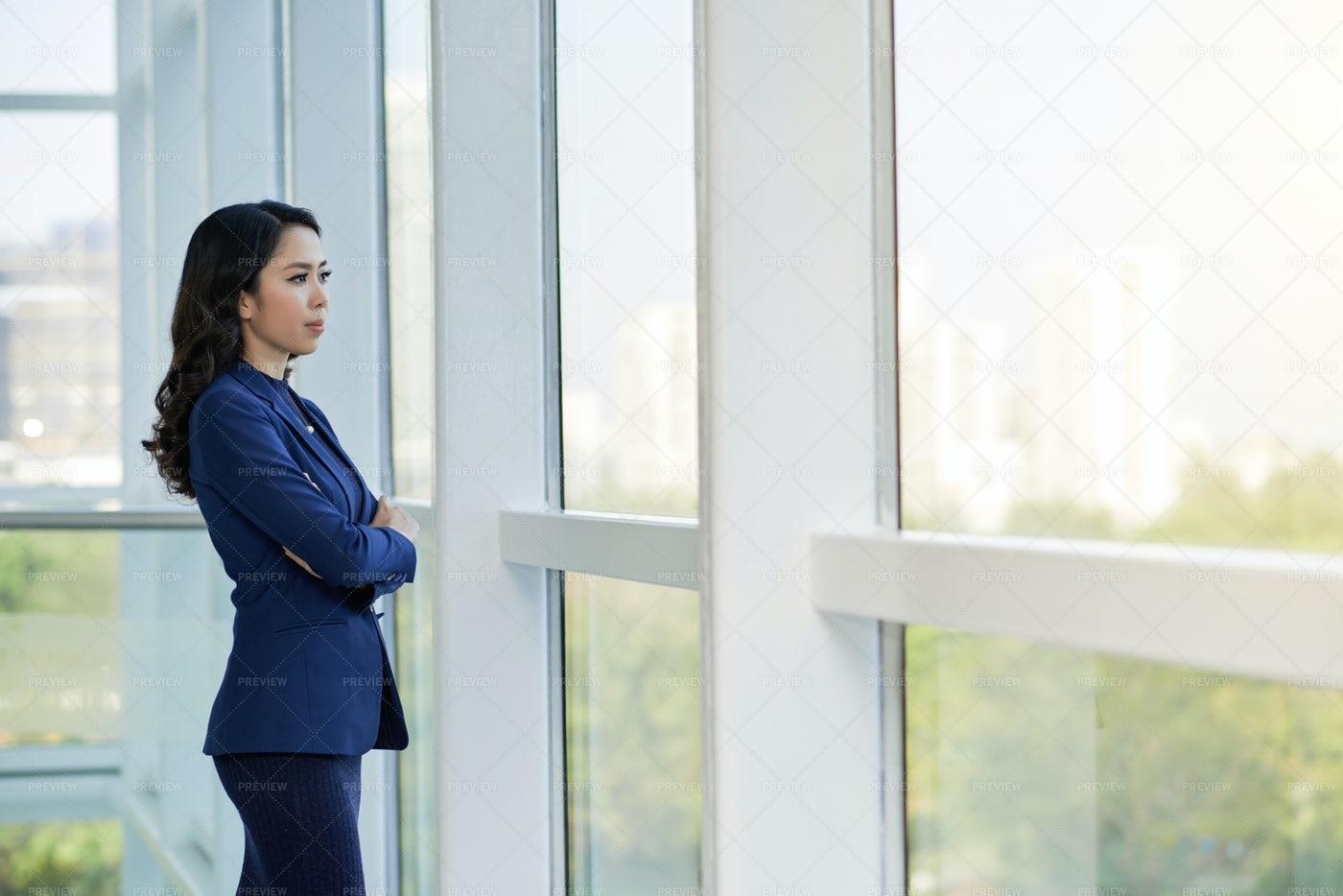 Pensive Businesswoman Standing At: Stock Photos
