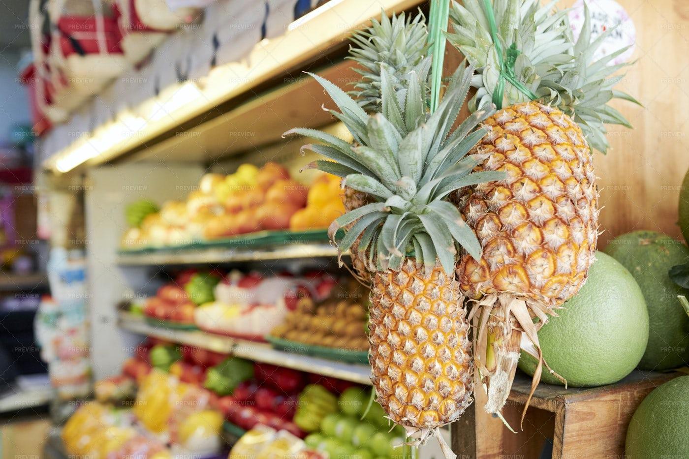 Pineapples Handing On Store Display: Stock Photos