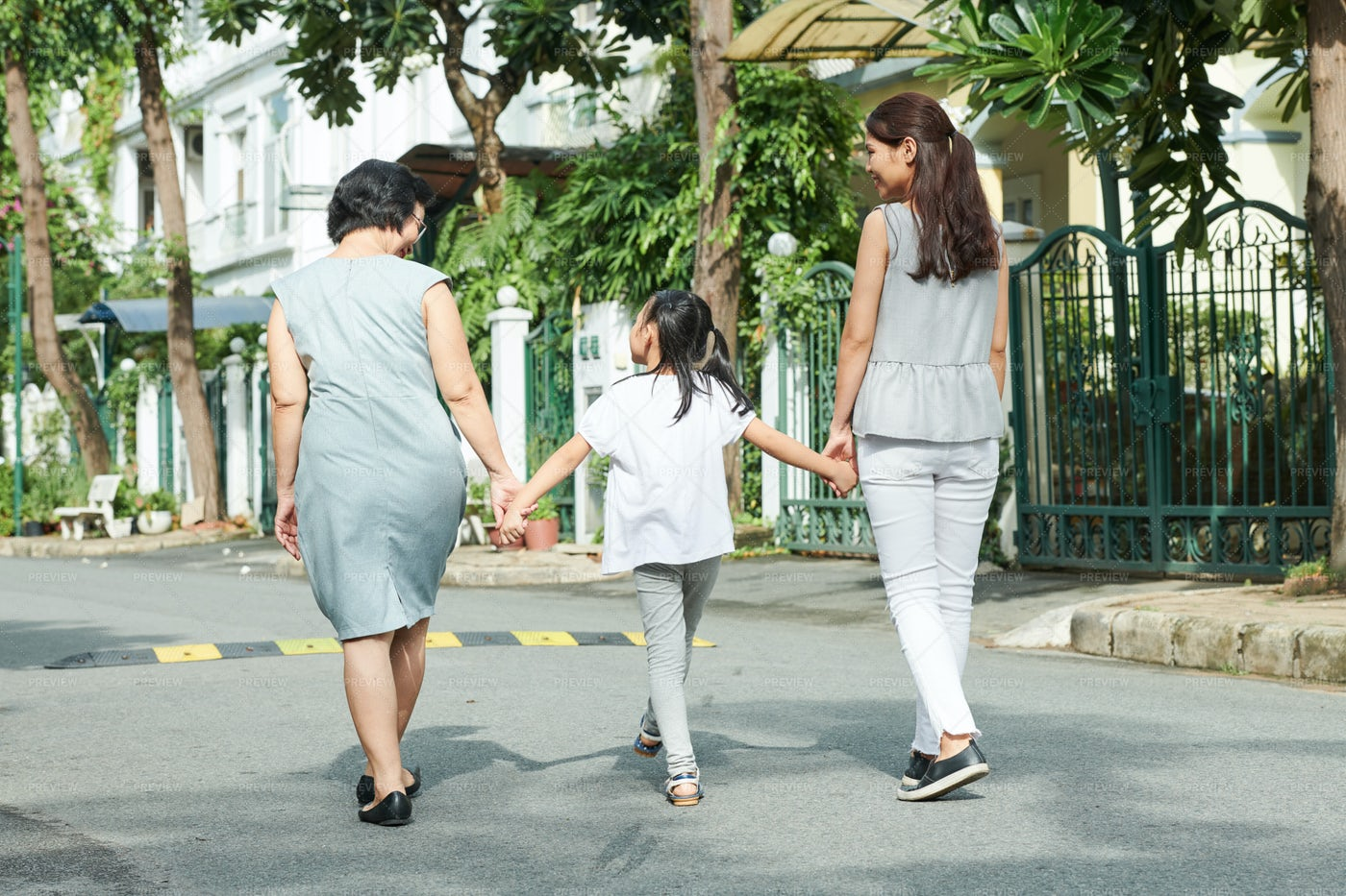 Family Walking In The City: Stock Photos