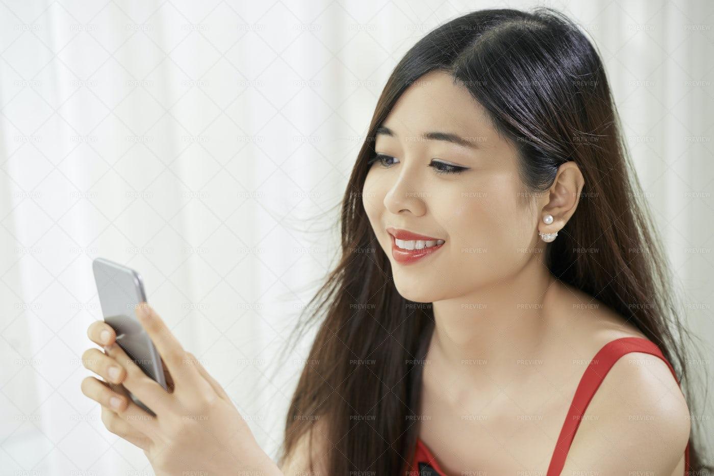 Asian Woman Using Smartphone: Stock Photos