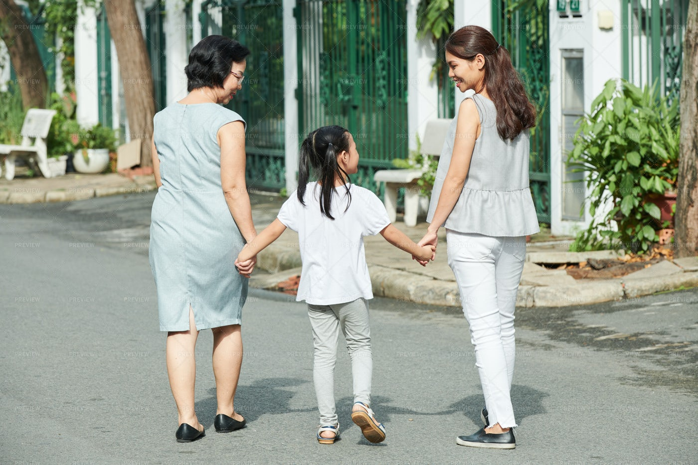 Asian Family Outdoors In The City: Stock Photos