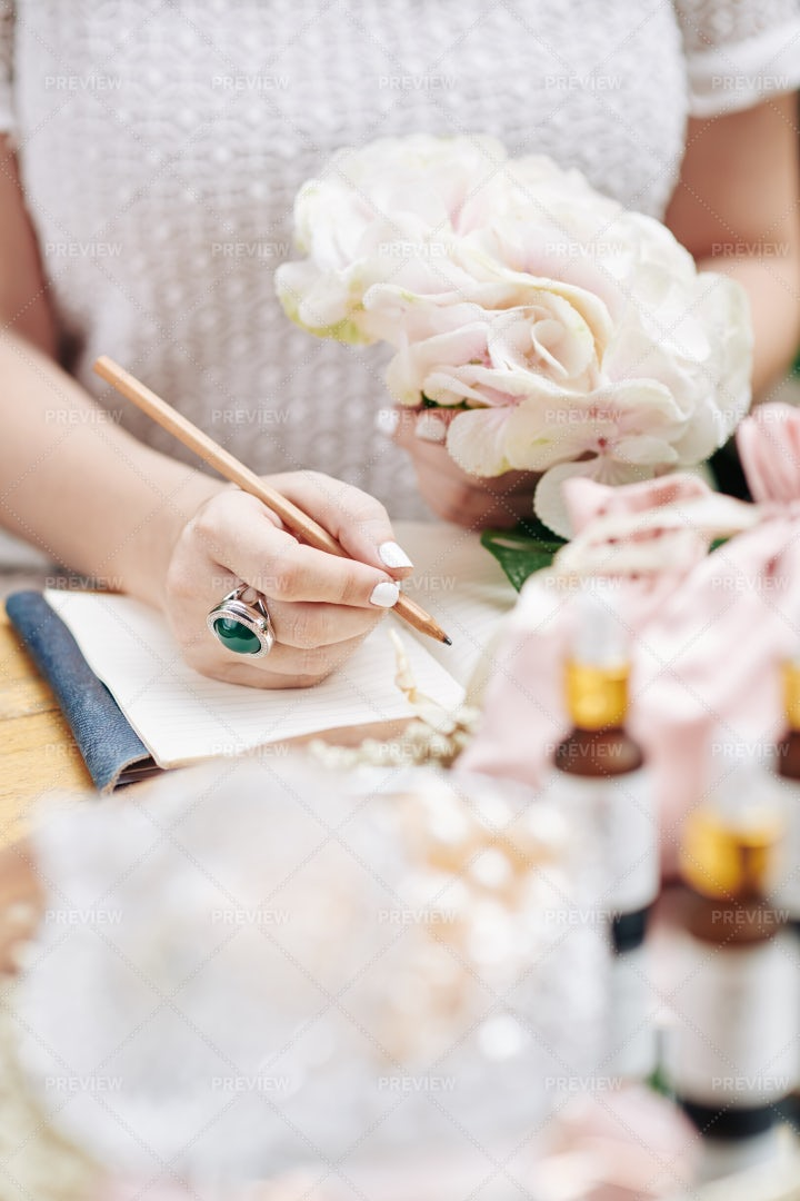 Woman Writing In Planner: Stock Photos