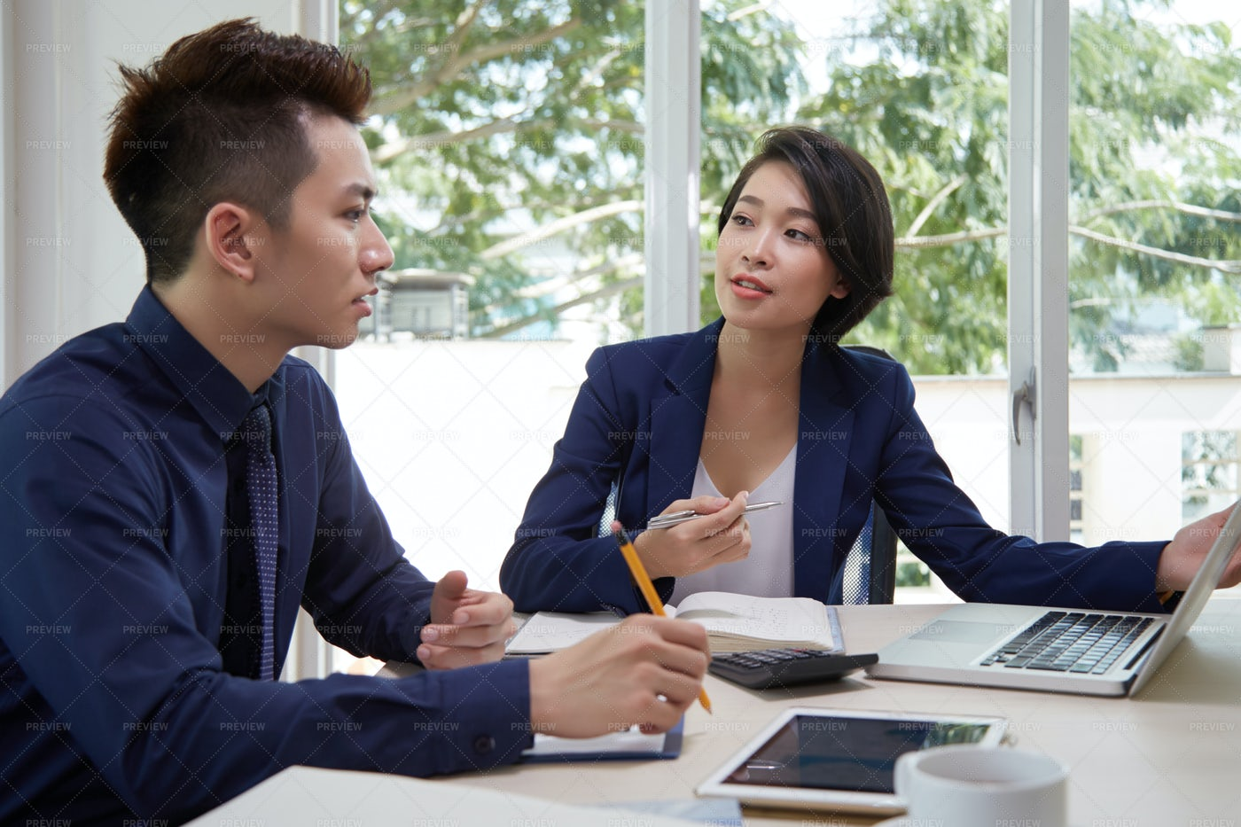 Business People Discussing New Business: Stock Photos