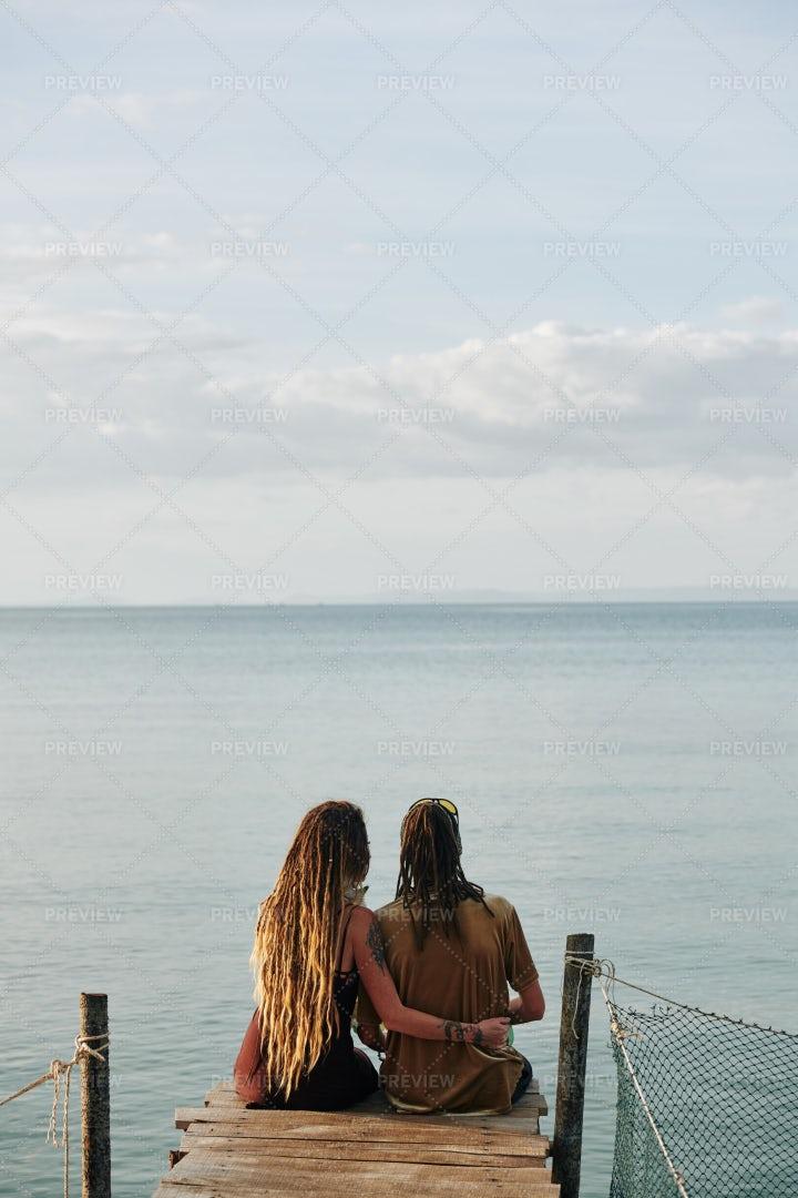 Couple Looking At Calm Sea: Stock Photos
