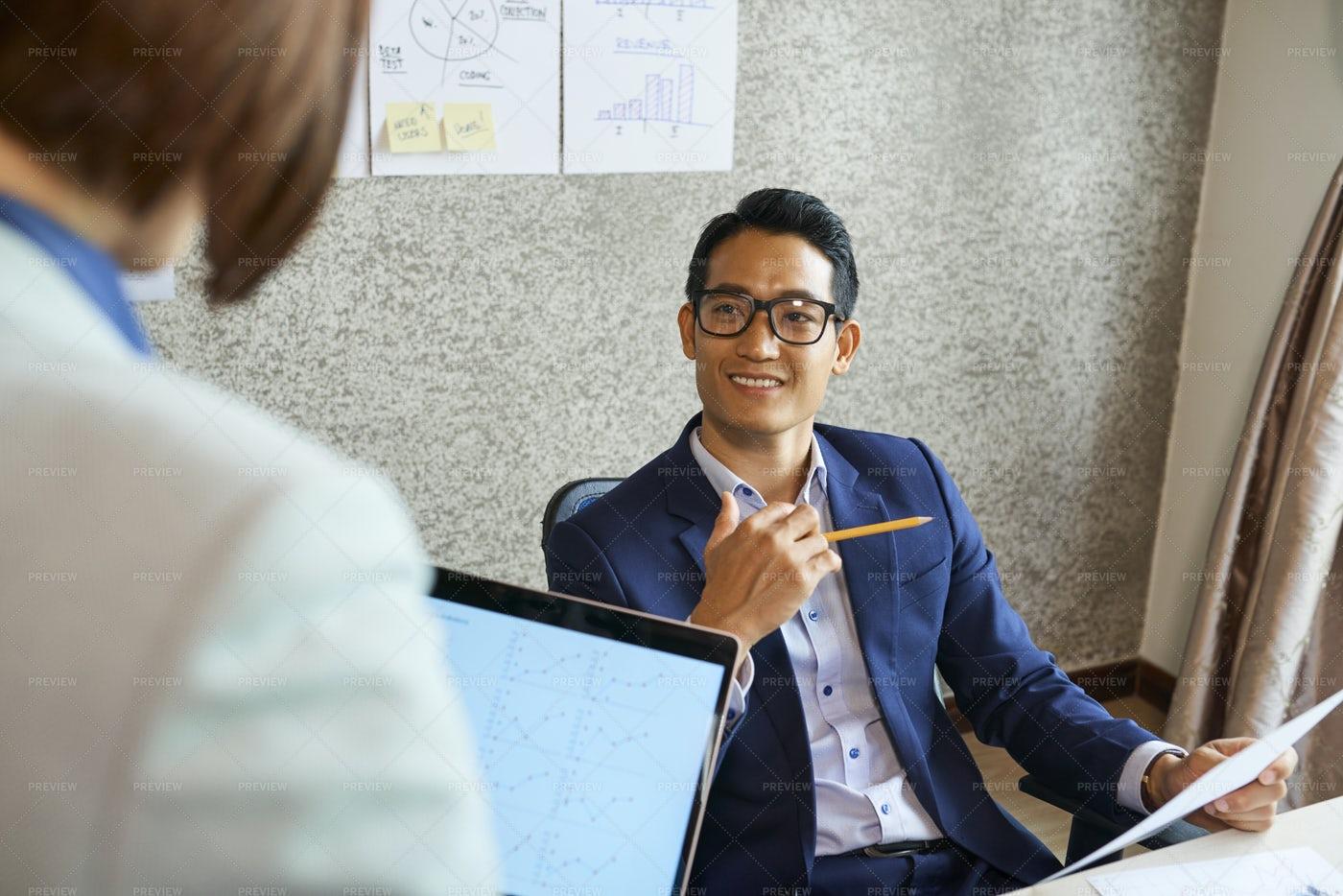 Smiling Entrepreneur Talking To: Stock Photos