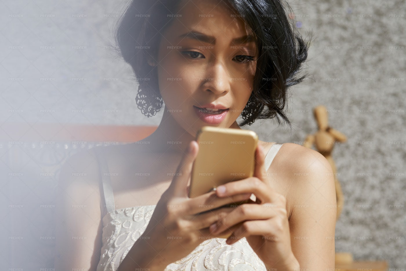 Woman Reading Article On Smartphone: Stock Photos