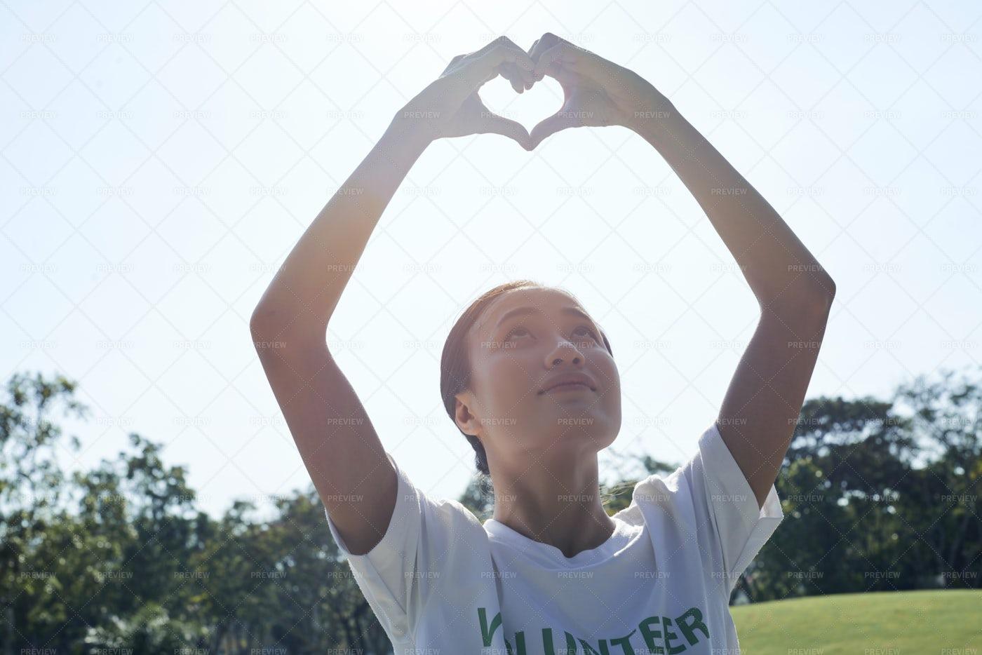 Female Volunteer Loves Her Job: Stock Photos