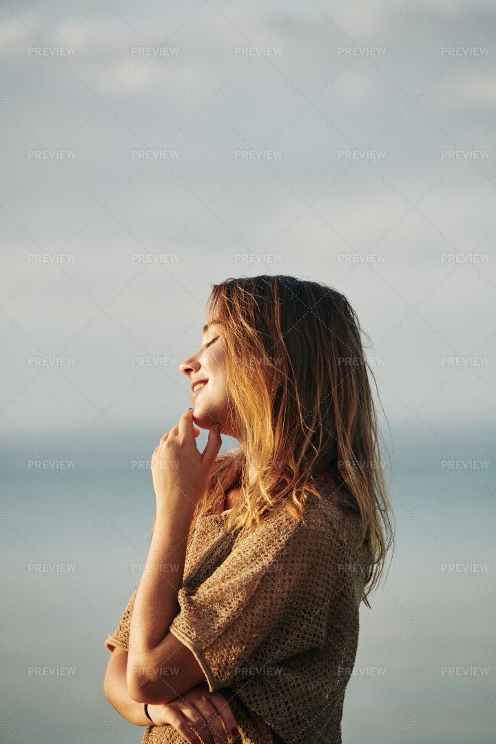 Woman Standing In Sunset Sun Rays: Stock Photos