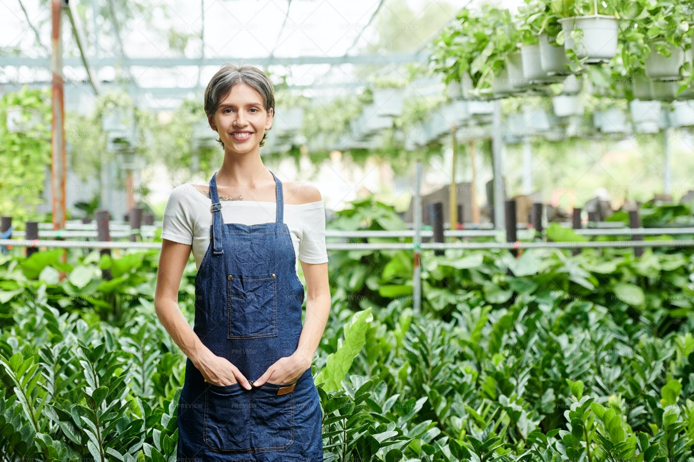 Pretty Smiling Greenhouse Worker: Stock Photos