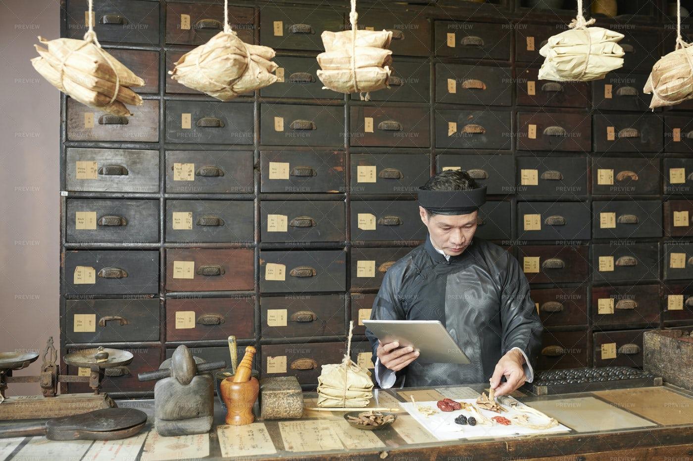 Man Selecting Dry Herbs, Mushroom And: Stock Photos