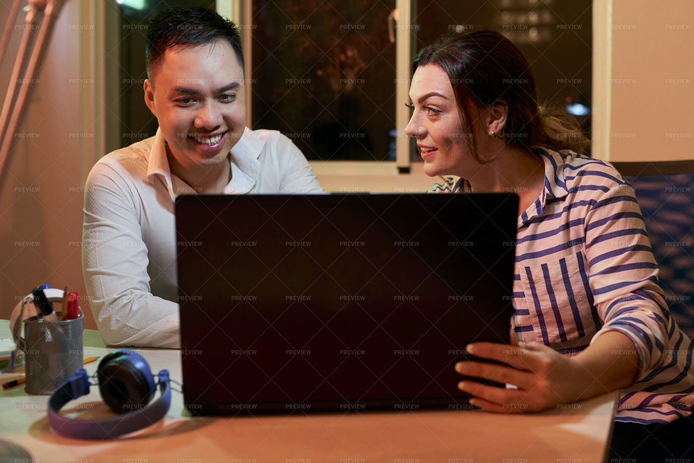 Business Couple Working On Laptop At: Stock Photos