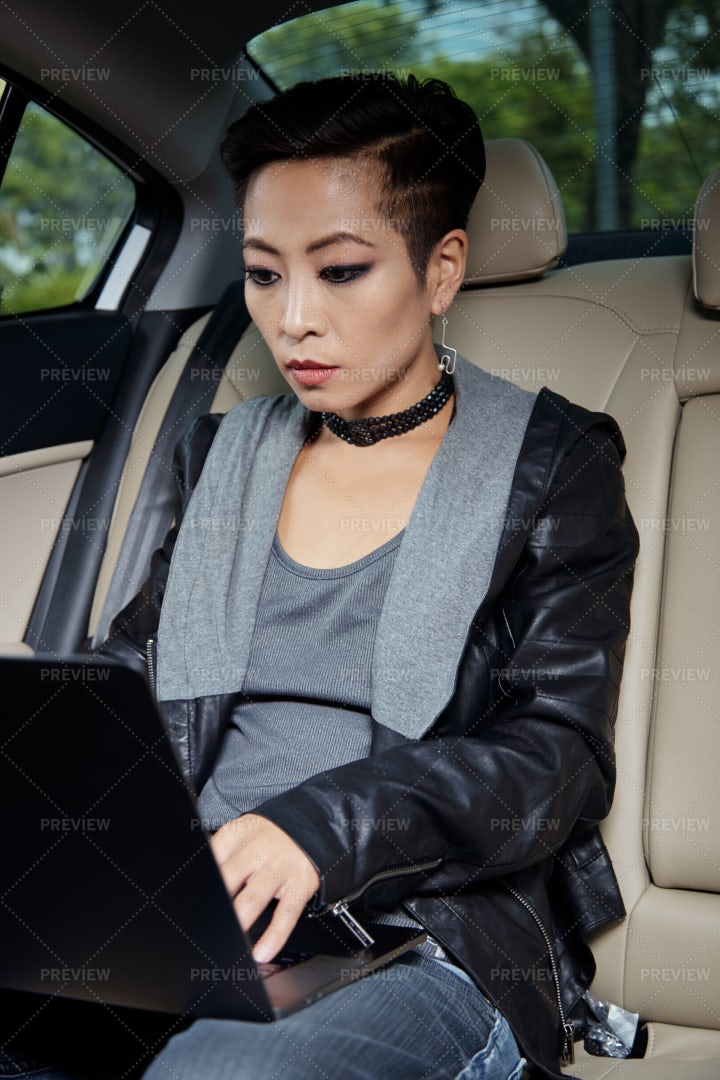 Woman Working In Car: Stock Photos