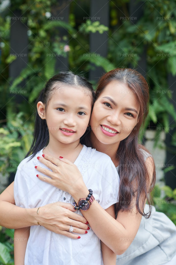 Asian Mother With Little Daughter: Stock Photos
