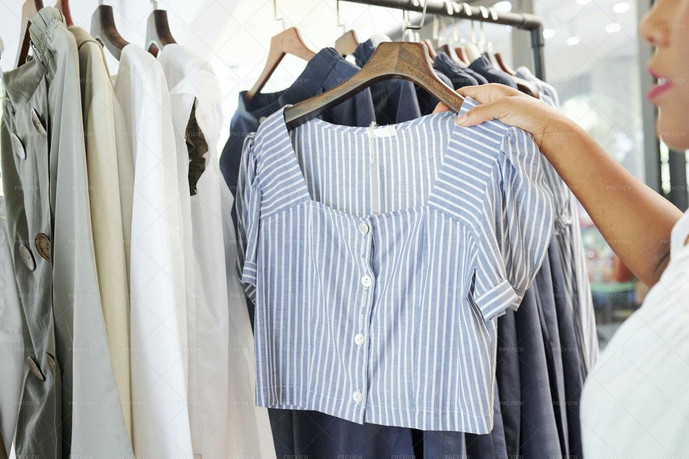 Woman Choosing Blouse On Clothing Rack: Stock Photos