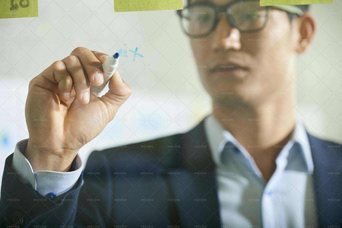 Businessman Writing On Glass Wall: Stock Photos