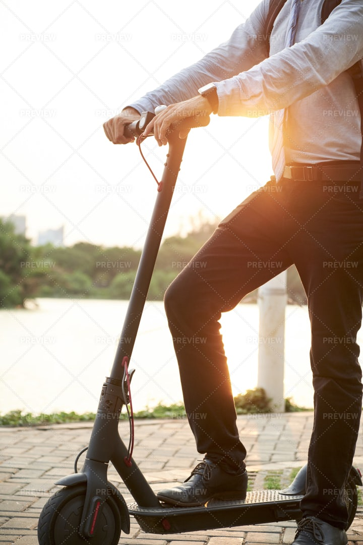 Man Riding On Scooter In The Park: Stock Photos