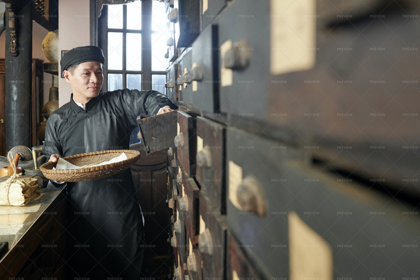Smiling Traditional Apothecary Worker: Stock Photos