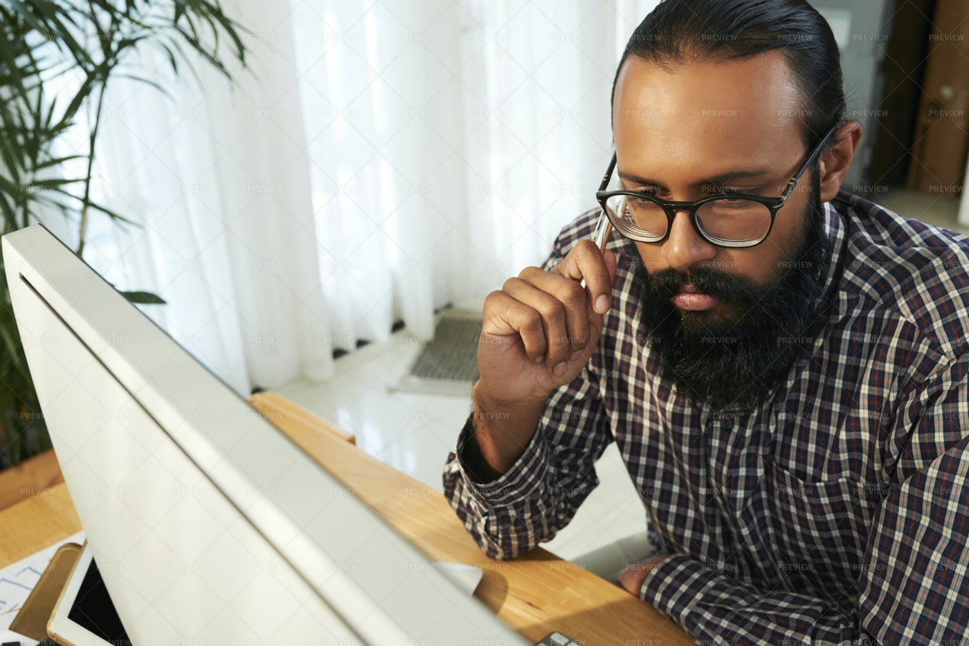 Pensive Businessman Working With: Stock Photos