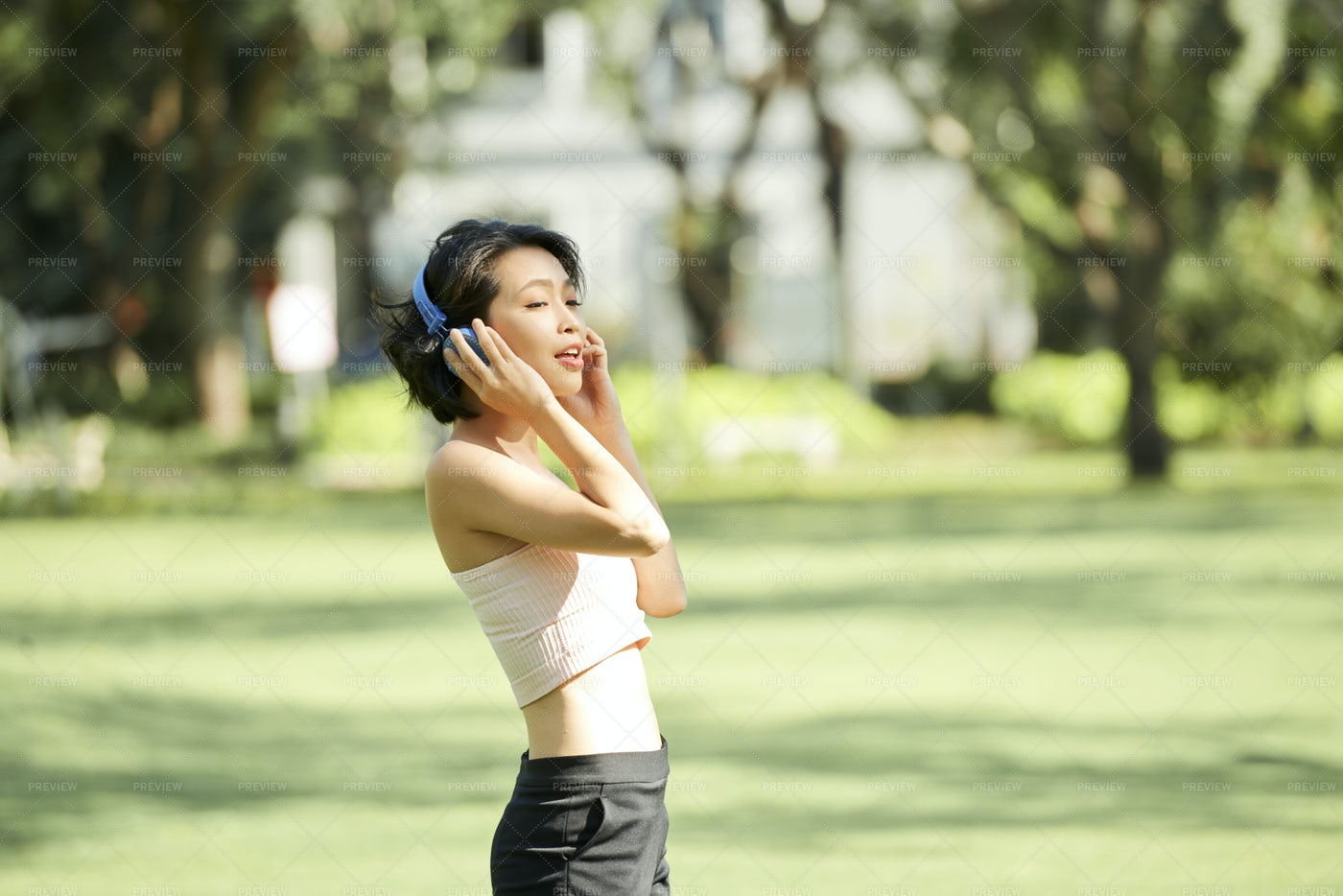 Singing Sporty Young Woman: Stock Photos