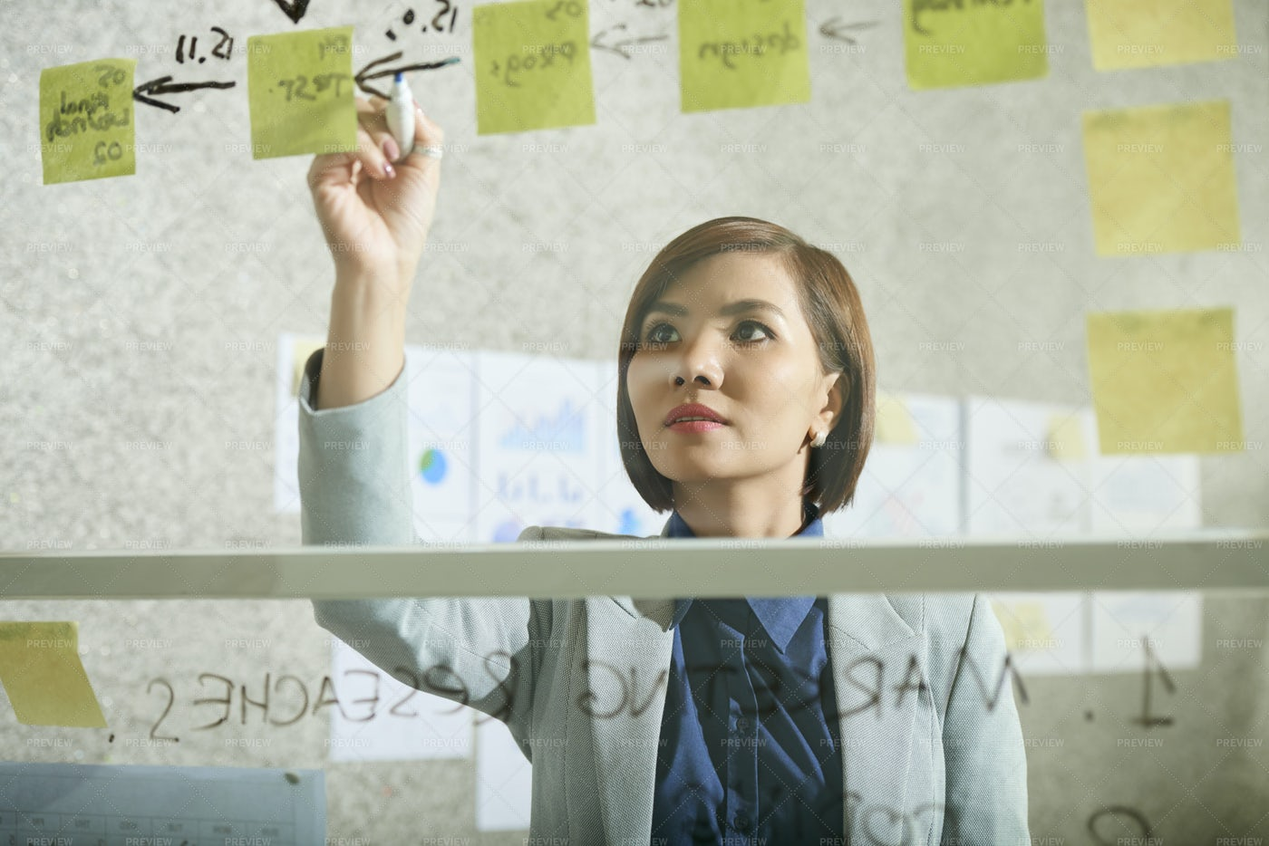 Businesswoman Drawing Sequence Of Steps: Stock Photos