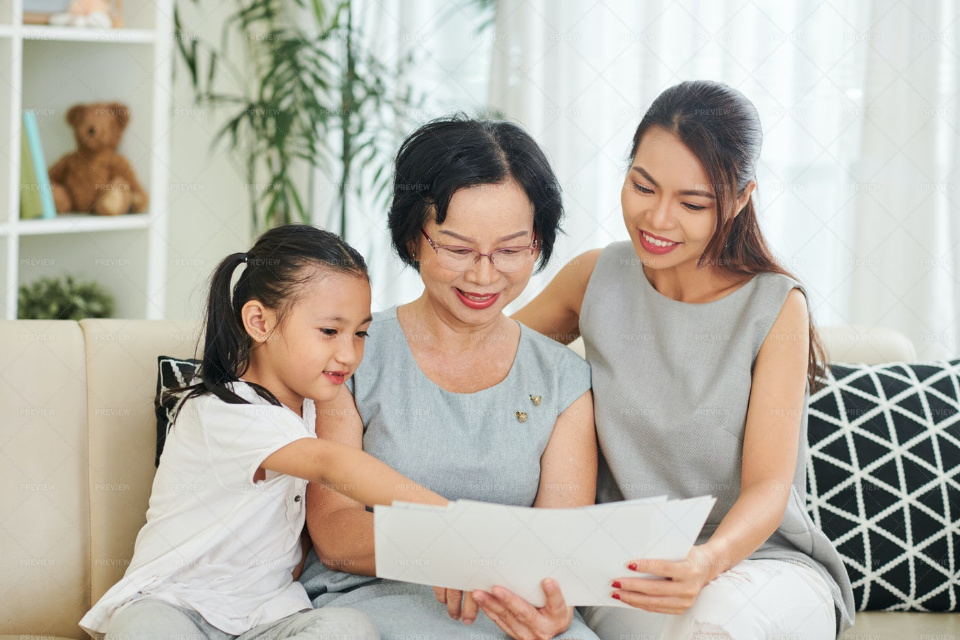 Family Reading A Letters At Home: Stock Photos