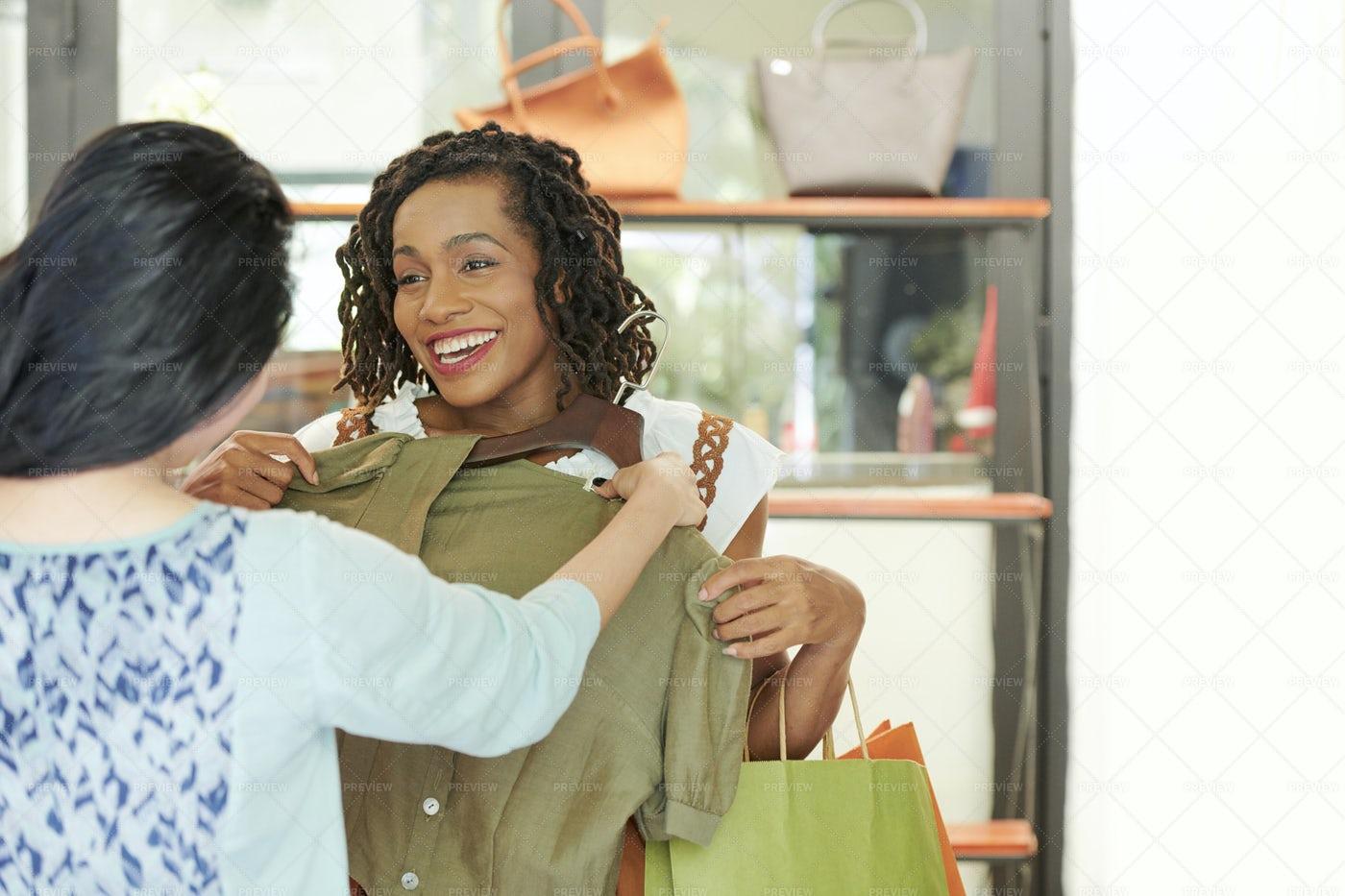 Friends Choosing Dress At Store: Stock Photos