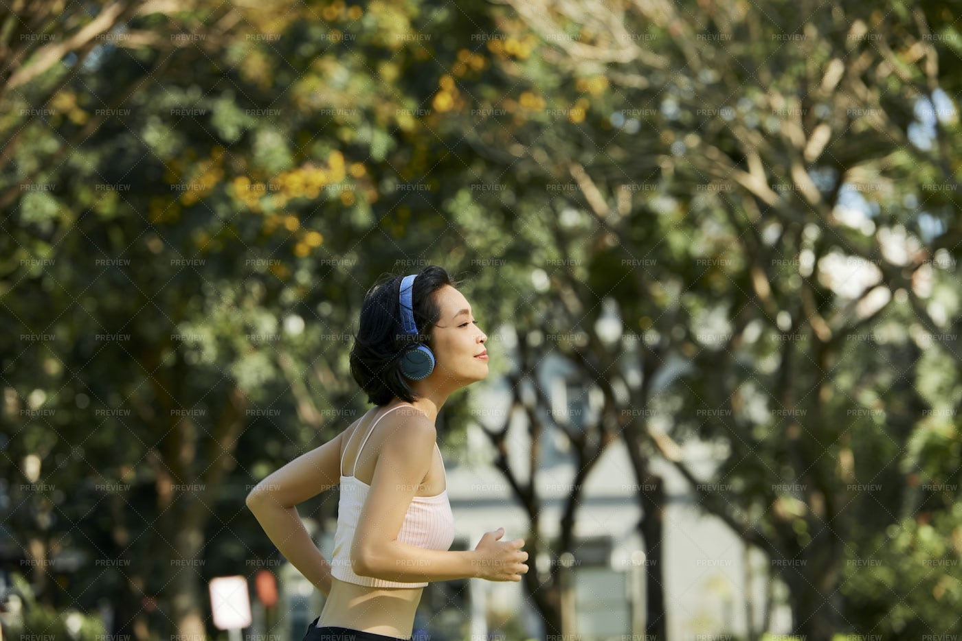 Fit Woman Jogging In Park: Stock Photos