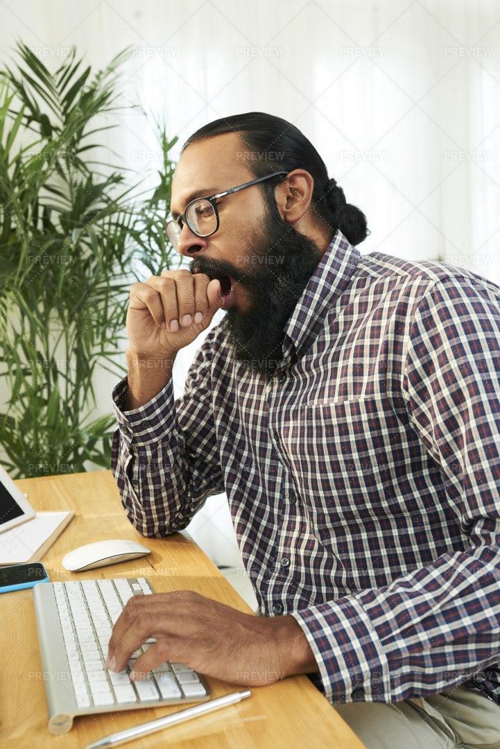 Man Yawning At His Workplace: Stock Photos
