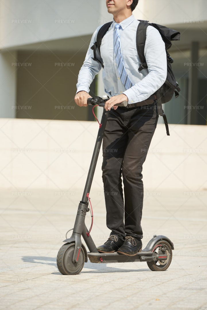 Businessman Riding On Electric Scooter: Stock Photos